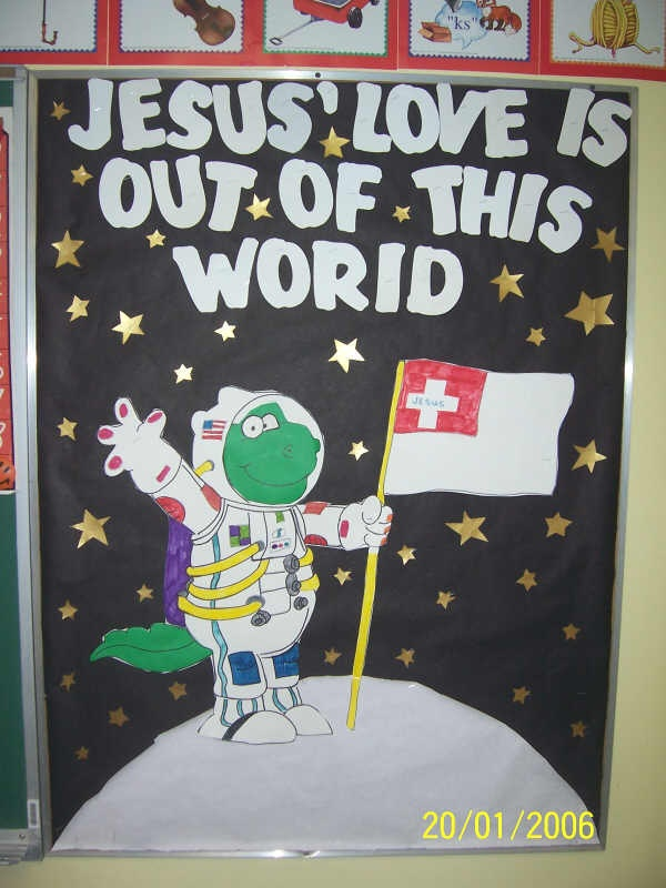This bulletin board confuses the crap out of me. Is this an alien? Is it a dinosaur . . . In space? WTF?
