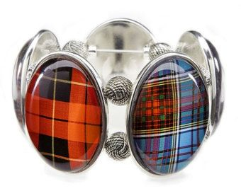From the classic Thermos bottle, to the red carpet (in other words, from Kitsch to Couture), we are mad about plaid.  Five Campbell tartan swatches mix and mingle on this gold and pearl multi-Joolz stretch bracelet. (Also available in silver - see additional photo.)  - One size - Super water-resistant and can be worn in the rain, while washing dishes, etc... - Weight: 3 oz. - Ships packaged in our fabulous pouch and gift box - Made in our studio in Warwick, RI  Visit our website…