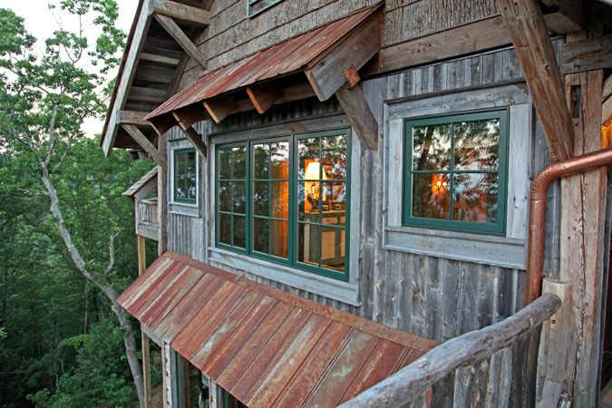 Nice eave shelter over the window.  Log Home Designs | Rustic Home Designs | Timber Framed Homes