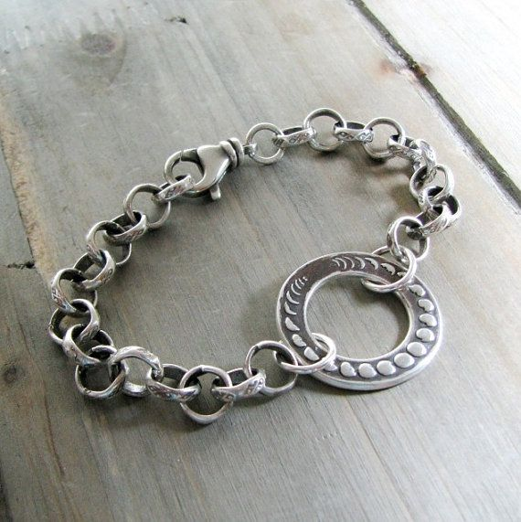 A shining tribute to the phases of the moon, handcrafted with luminous fine silver. There are many beautiful meanings and interpretations of the moons cycle. To some, it represents immortality and eternity. Others see the phases of human life. Some see the moon as a bridge between night and day; the world between the conscious and unconscious.  This bracelet, like all of my jewelry, has been handcrafted with love and attention to every detail. Each is made with my own hands, here in my small…