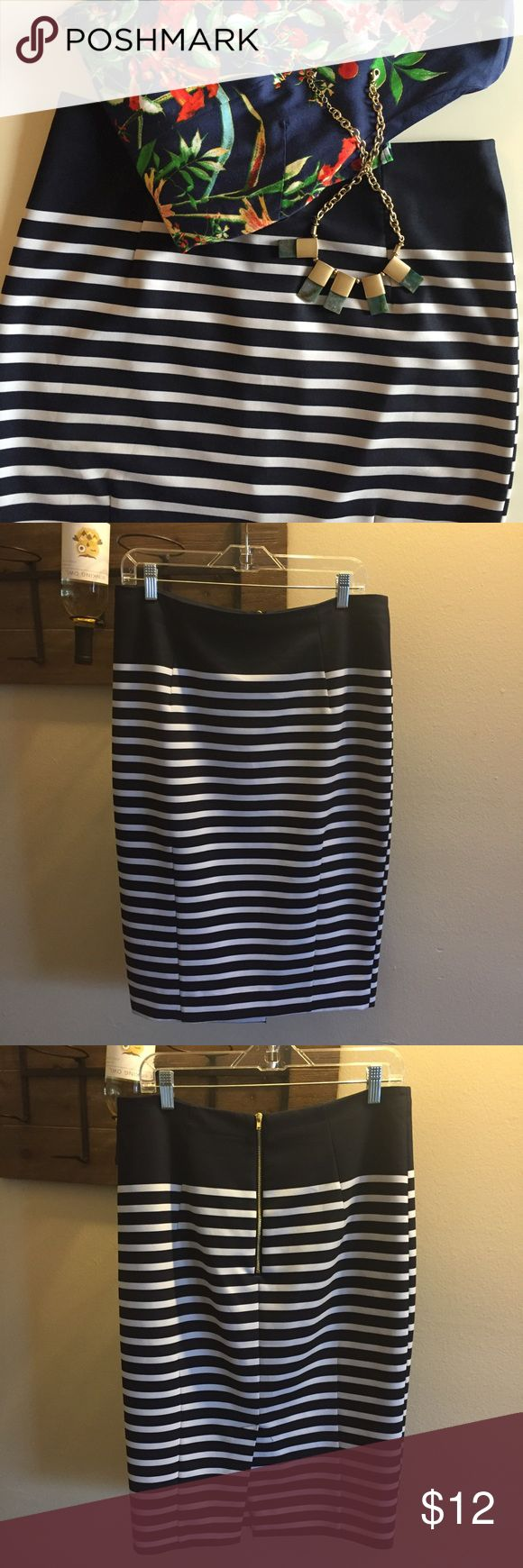 Navy & white striped pencil skirt One of my favorite skirts that no longer fits! Has a flattering, scuba style to it that makes a statement! Has exposed zipper and a back split. Measurements pictured. H&M Skirts Pencil