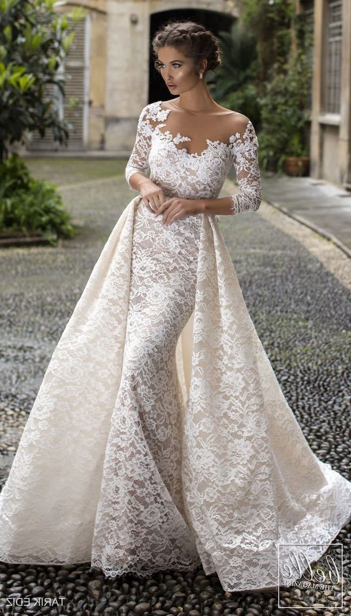 Flowy Wedding Dress Braided Brown Hair In A Low Updo Lace Dress Lace Train Off Shoulder L Form Fitting Wedding Dress Wedding Dresses Fitted Wedding Dress [ 1230 x 700 Pixel ]