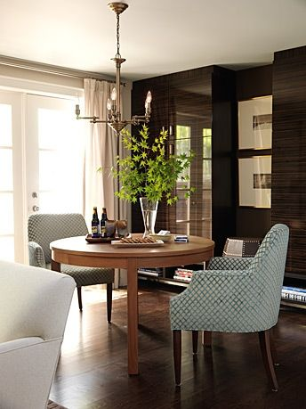 """The family room from #SarahRichardson's website's portfolio of #SarahsHouse season 2. The family room has a more masculine aesthetic than the #pink living room. Rather than having all rooms gender neutral, each room has its own """"gender"""". This is the eating/board game area."""