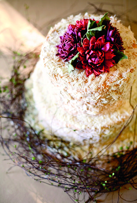 Wedding cake adorned with vines and twigs, and topped with edible flowers. Photo: Gertrude & Mabel. #edibleflowers #flowers #recipes #food #home #meals #yourhomemagazine