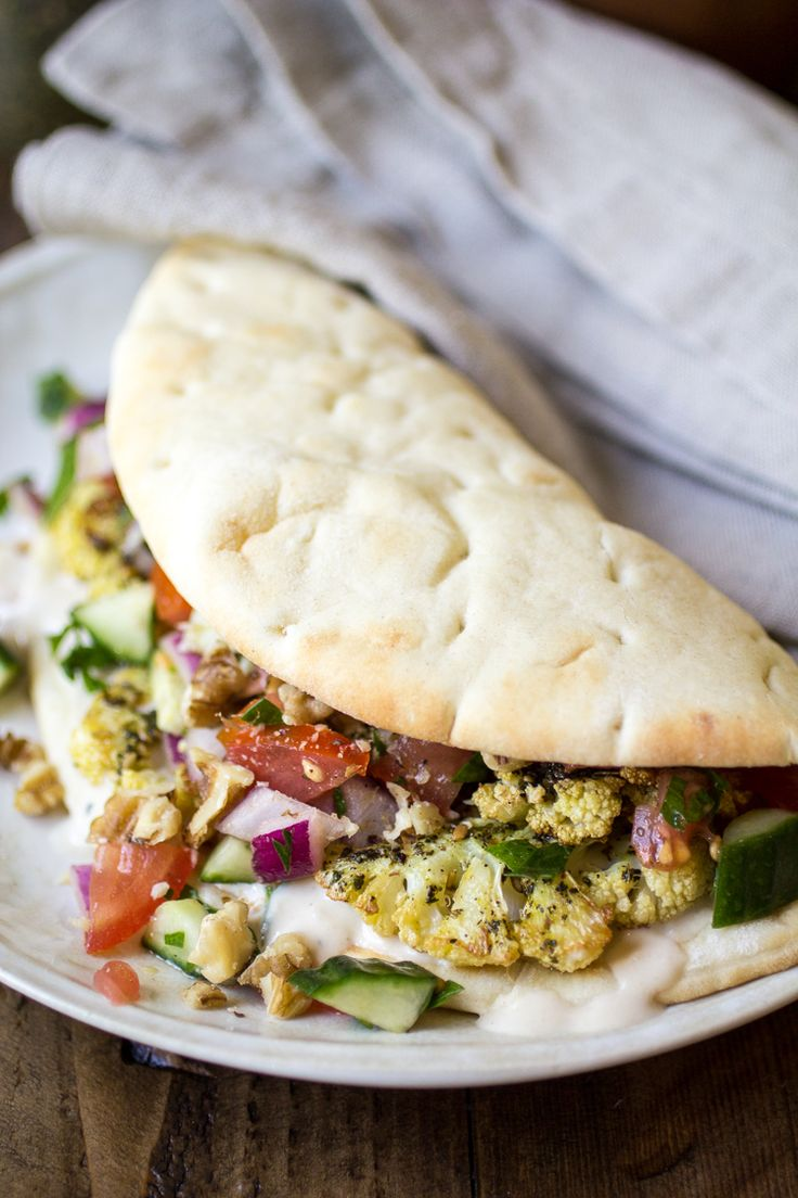 Vegan Pita Sandwiches: made with zaatar roasted cauliflower, Jerusalem salad, and an easy tahini sauce. The perfect vegan lunch!