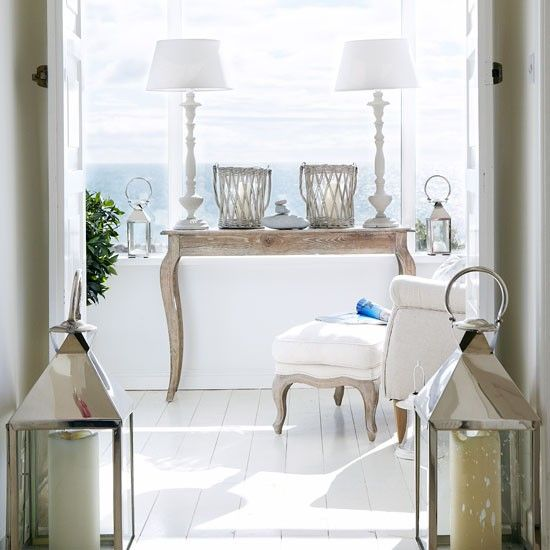 French-style furniture and a beautiful ocean backdrop.