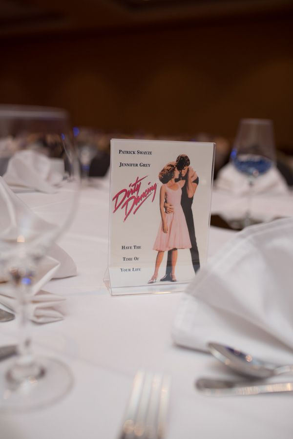 This bride and groom used their favorite 80's movies as themes for the reception tables. Such a fun idea!