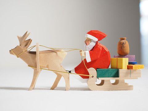 Santa riding sleigh – Adornare
