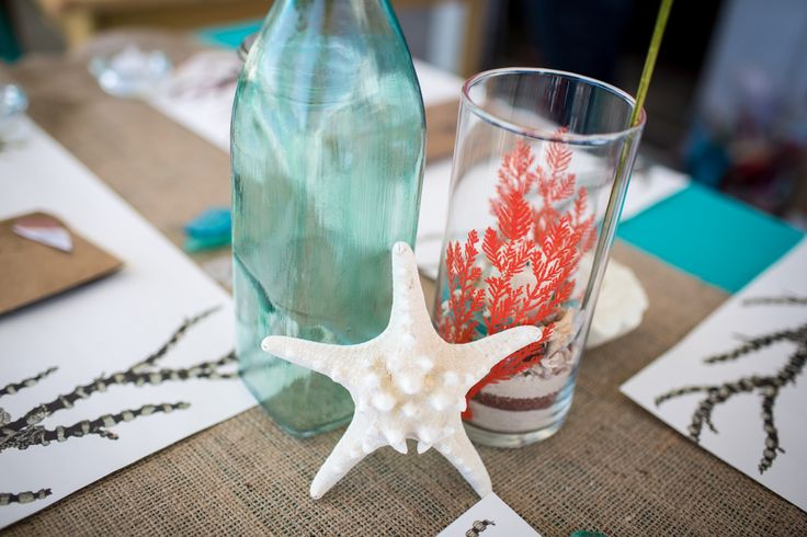 Beach wedding centerpieces can be as simple as this one (plus, you can probably make sea glass too).