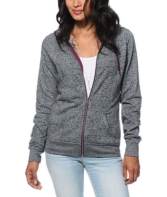 A comfortable zip up hoodie cut with a flattering slim fit is in a speckled black colorway and features a contrast purple zipper and drawstrings for style.