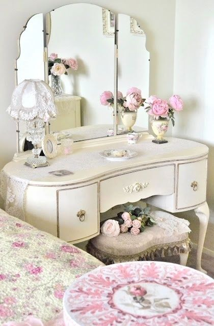 I love this old vanity painted white for a dainty bedroom