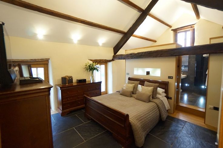 The bedroom at The Barn in Capel Garmon, which is on the market for £465,000