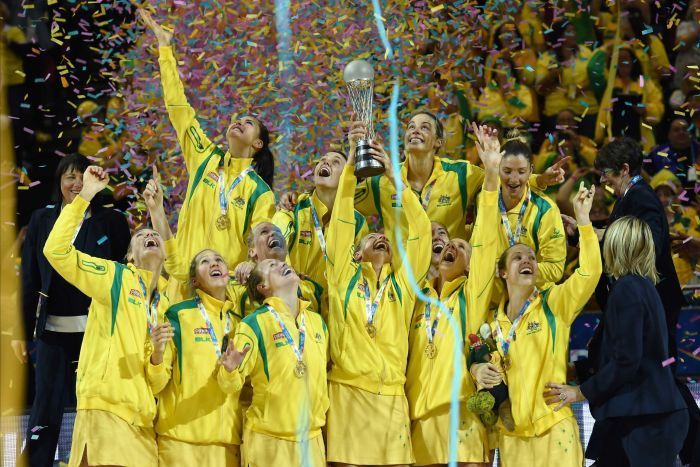 The Diamonds celebrate with the World Cup trophy