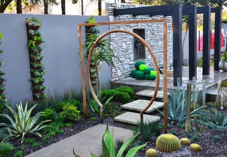 Rusted steel, contemporary moon gate. Open patio with steel pillars
