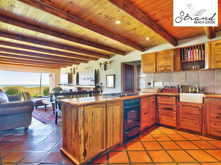 Our fully equipped kitchen begs for social meal preparation with a living area leading out to the porch, lawn and beach in front. Link: http://ow.ly/jzXQ30biEku