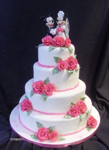 bright and colorful mickey cakesminnie cakemickey mouse weddinganniversary