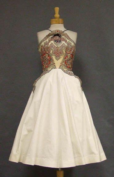 Vintageous, LLC - KNOCKOUT Printed Cotton 1950's Cocktail Dress w/ Beads, $210.00 (http://www.vintageous.com/knockout-printed-cotton-1950s-cocktail-dress-w-beads/)