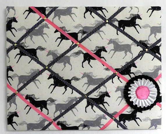 French memory board/ pin board featuring equestrian fabric and horse show ribbons. Features unicorn fabric. Made by English Rein and available at https://www.etsy.com/listing/563470935/french-memory-board-padded-pin-board