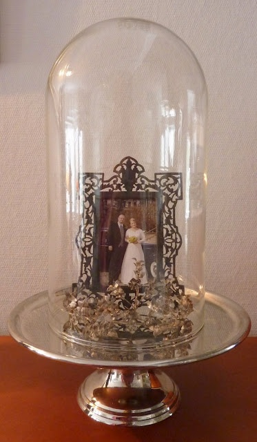 cloche and silver with antique frames and old pictures
