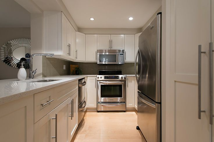Stainless steel appliances, soft closing drawers and a built in pantry.