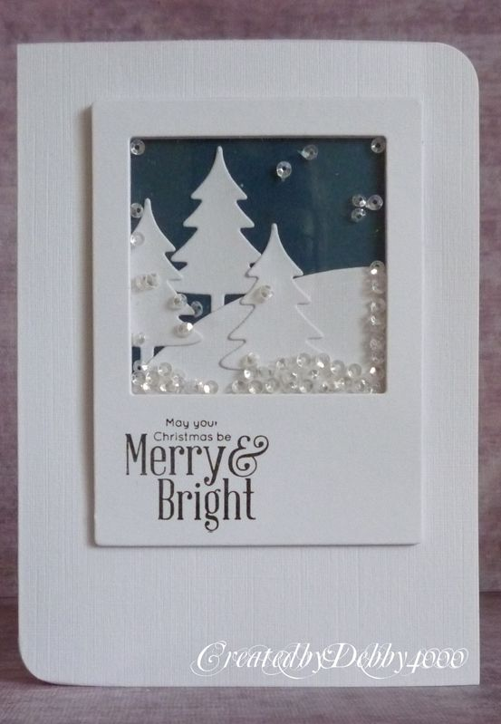 white winter christmas shaker card using polaroid frame enclosing paper trees and sequins