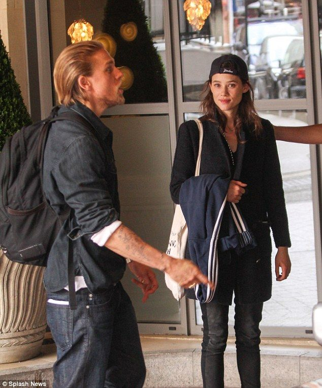 Inked up: Charlie Hunnam stepped out in his native England on Tuesday with Spanish actress...