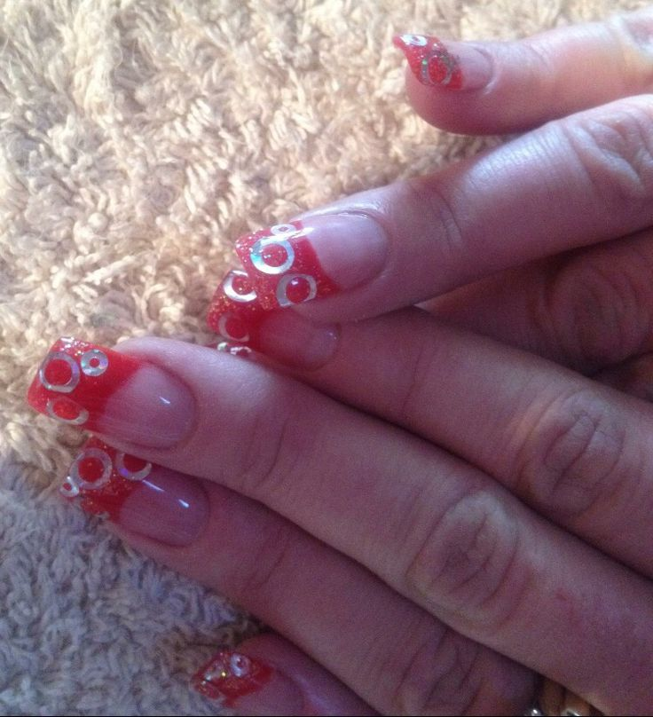 French Nails with red glitter acrylic and decals.