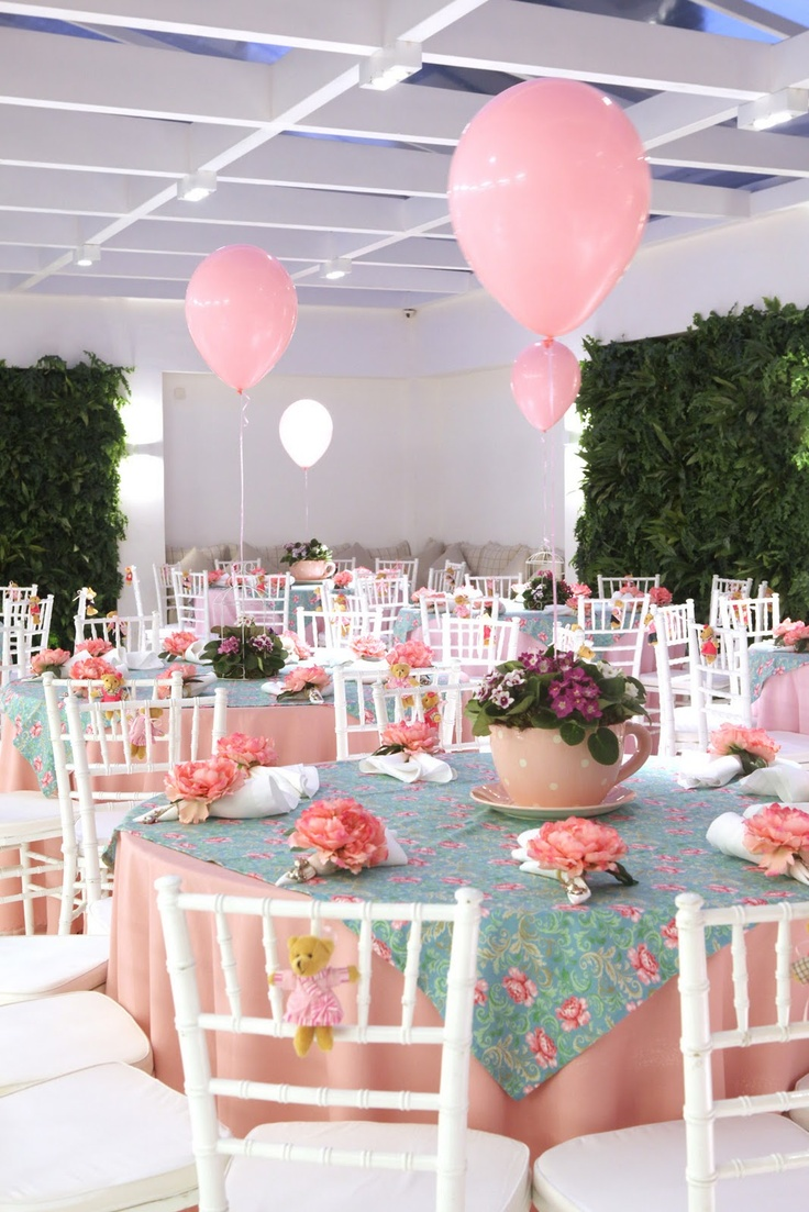 Large tea cup centerpieces with flower napkin rings