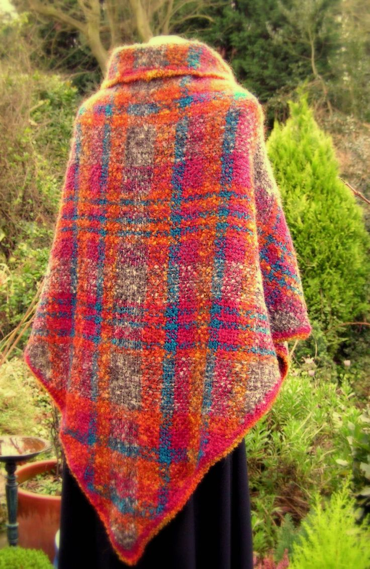 7' triangular shawl woven on a tri-loom. Wool, mohair and other fibres twisted together on a spinning wheel to make a unique yarn and a spontaneously woven unique shawl by Joan Kent.