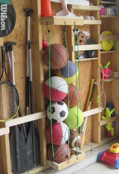 Use bungee cords to easily store sports balls, and nail slats to the studs in your wall to create pockets for storing other sports equipment.