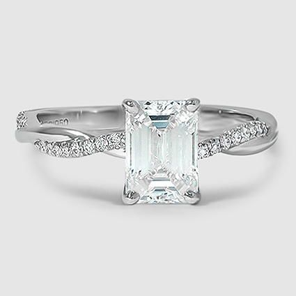 Our petite twisted vine diamond ring set with a 1.21 carat emerald cut diamond. #BrilliantEarth