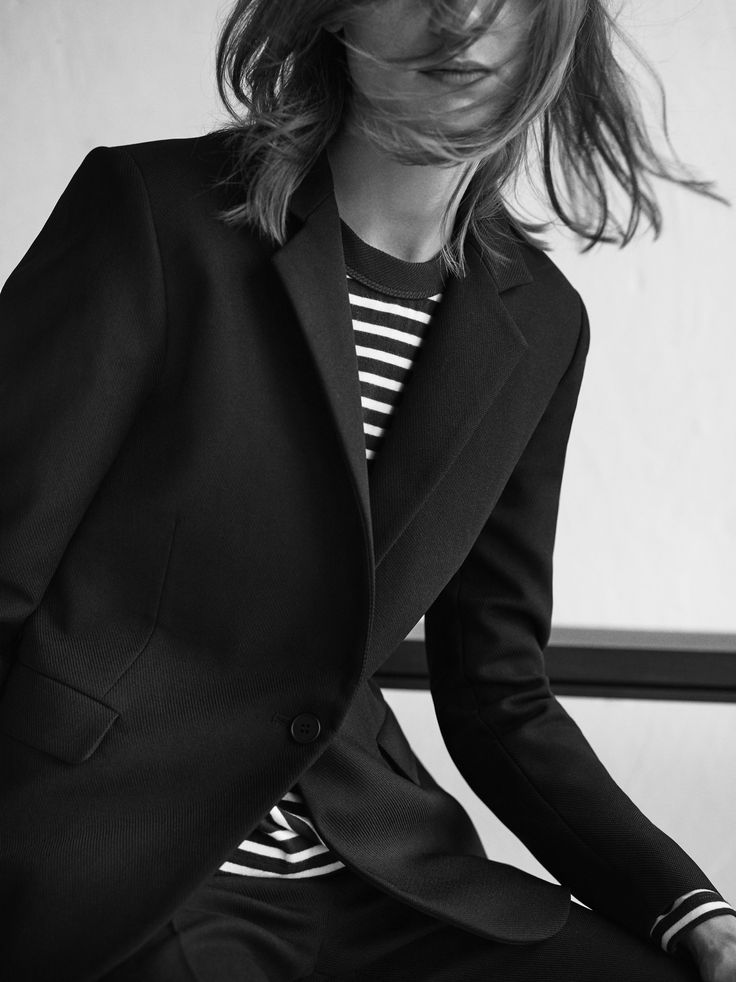 The black textured fitted blazer by our Boutique line is a workwear essential.