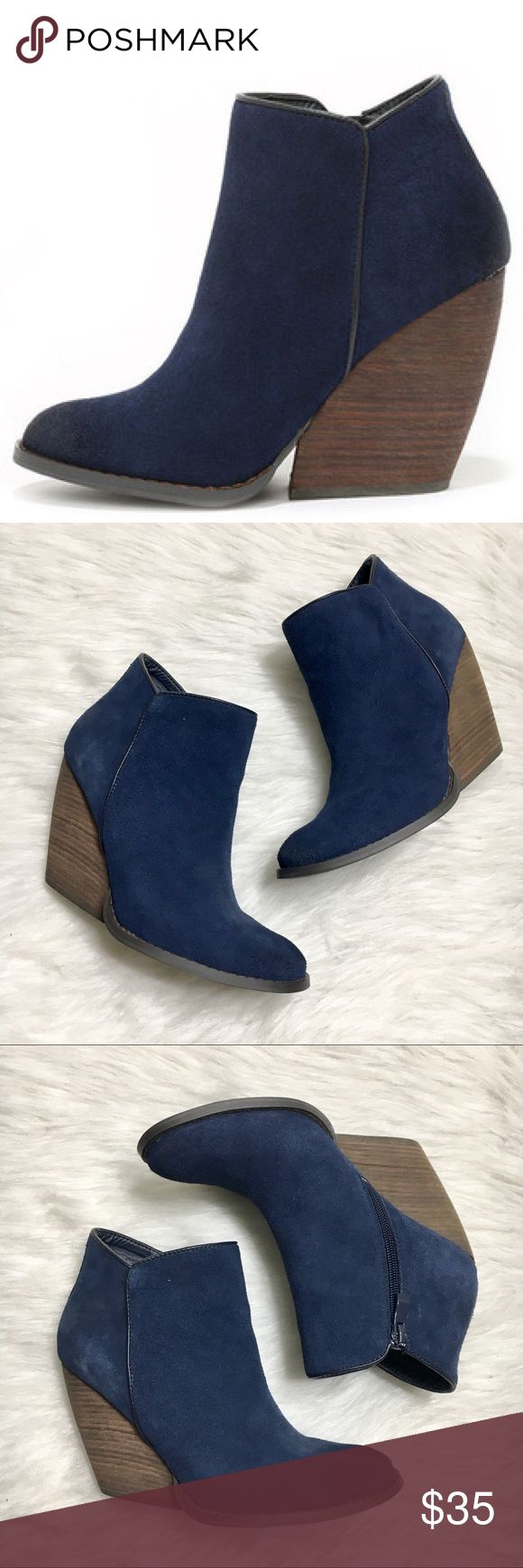 """Very Volatile Whitby Navy Ankle Boots Great condition! No flaws! Leather upper. Heel height: 4"""" Wedge has a really cool cut to it. Very Volatile Shoes Ankle Boots & Booties"""