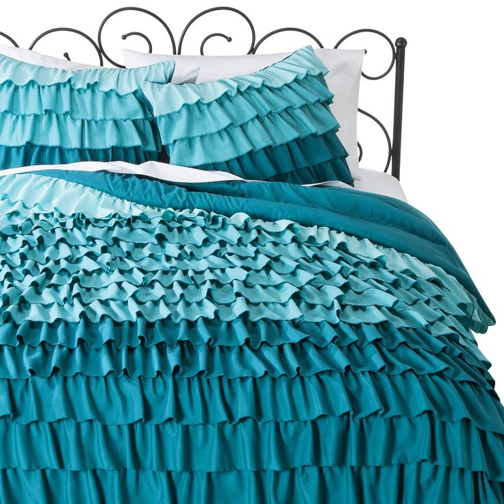 Give your daughter a room fit for a princess with an Xhilaration Ruffle Comforter Set. This ruffled comforter and pillow sham set has a modern ombré design with layers upon layers of ruffles. With the 100% cotton cover and soft polyester fill, the comforter will keep her warm and cozy all night long. Her room will take on a whole new look with this girls' bedding.