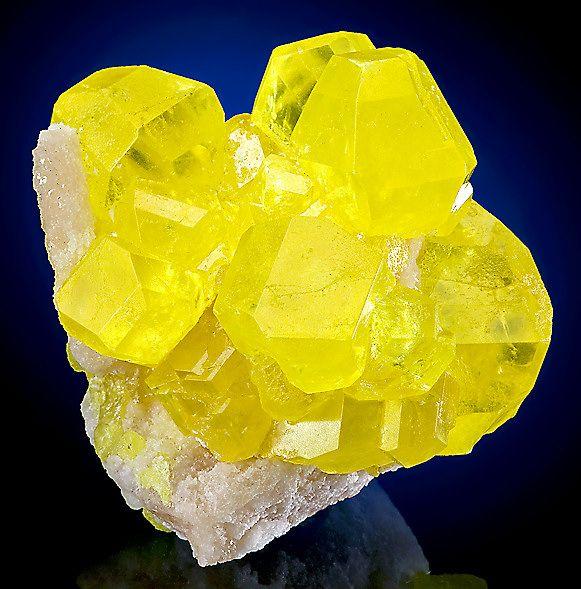 Sulfur Crystals on Aragonite Matrix
