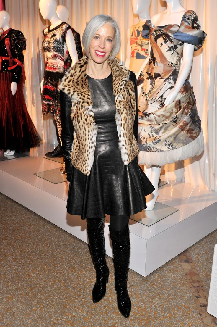 What's missing from an over-the-knee boot and black leather dress ensemble? Oh right, an animal-print fur vest. #boldygo  www.workinglook.com