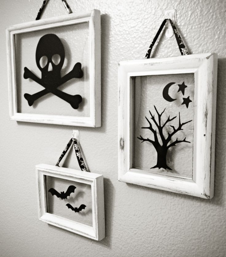 Halloween Floating Frames. Could use dollar store window cling decorations for different holidays.