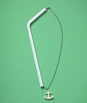 To avoid tangles when you travel, slip your necklace through a drinking