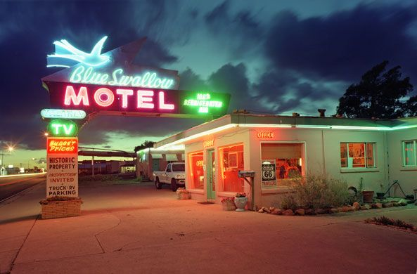 Credit: Courtesy of Tony & Eva Worobiec Blue Swallow motel, Tucumcari, New Mexico.  Roadside cinemas, diners and motels sprang up in the 50s and 60s, created for newly motorised families to enjoy as leisure time increased and the desire to see the sites of America grew