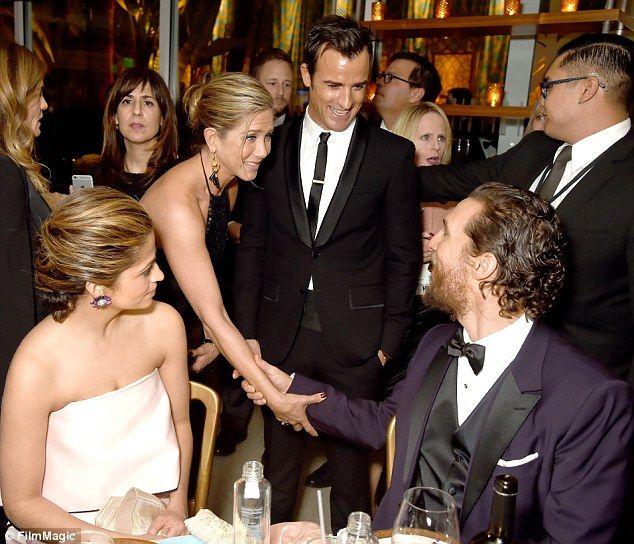 Meet and greet: Jen looked genuinely pleased to see Matthew as she shook hands at the even...