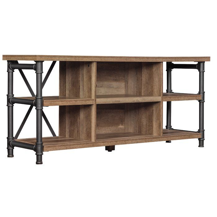 Host movie or game night in front of this open architecture, multi use TV stand with a mixed wood and metal design, the large open shelves are suitable for audio or video components and decorative items for display. This TV stand was designed to provide plenty of air circulation for cooling of gaming and audio components. The holes in the rear provide easy cable management to keep your entertainment area looking clean and organized. This TV stand can also be used as a console, accent table…