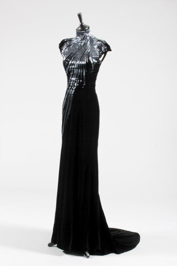 An Alexander McQueen black velvet and bugle beaded evening gown, 'In memory of Elizabeth Howe, Salem 1692' collection, Autumn-Winter, 2007 the silver-grey bugle beads forming a star-burst effect to the upper bodice which scatter as they descend down the trained skirt
