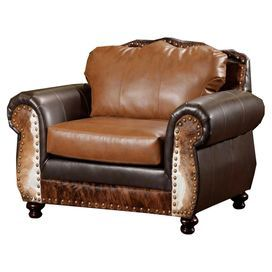 """Arm chair with cowhide-inspired accents and foam cushioning. Made in the USA.   Product: ChairConstruction Material: Wood, polyester and vinylColor: Brown and whiteFeatures:  Cushions made from hi-density foam coreZipper cushionsDimensions: 40"""" H x 56"""" W x 40"""" D"""