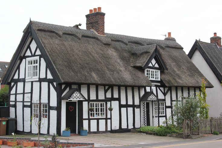 A thatched cottage in the village of Haslington, Cheshire, England - dating from the 17th century. While the building is 17th century, the date 1510 is inscribed on a board over the door