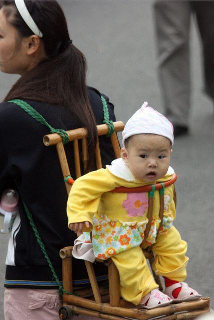 "Babywearing - looks like she got a ""good seat"""