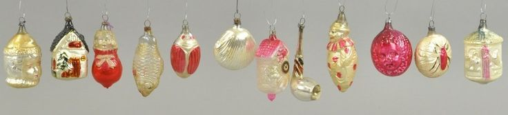 Bird houses, beetles, fish, clams and clowns make up this lot of blown glass Christmas tree ornaments