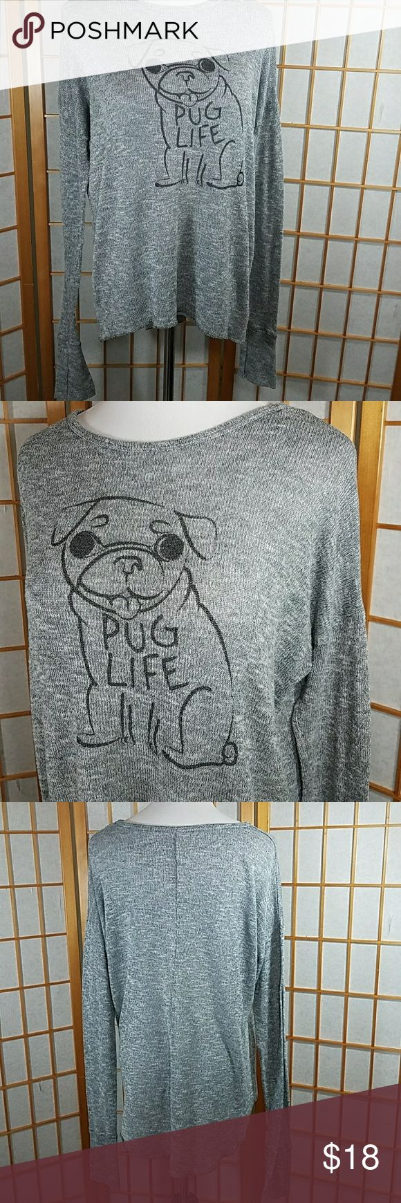 "Bethany Mota lightweight gray sweater with pug Bethany Mota lightweight gray sweater with pug, pug life saying. Bery light weight and comfortable extra long sleeves, and high low hem. Size Medium measures 20"" across from armpit to armpit when laid flat and 18"" across the waist when laid flat with some strech.  24"" long from back neckline to hem in the front and  26"" long in back. Excellent used condition. Bethany Mota Sweaters Crew & Scoop Necks"