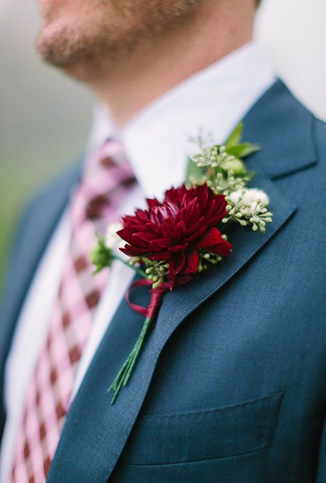 Brides.com: . A romantic boutonniere with a deep burgundy dahlia and seeded eucalyptus, created by  The American Club.