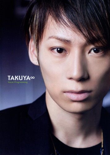 UVERworld- Takuya (stylized as TAKUYA∞) is the vocalist for the group as well as in charge of writing the band's music and programming. He was born on December 21, 1979 in Osaka while he later moved to Kusatsu, Shiga Prefecture.