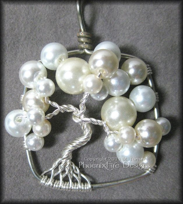 June Bride - Wedding Jewelry Bubble Tree of Life Pendant in White and Ivory Glass Pearls Set in Silver Wire Wrapped. $45.00, via Etsy.